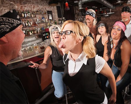 Aggressive female nerd sticking her tongue out at gang member Stock Photo - Budget Royalty-Free & Subscription, Code: 400-06557771