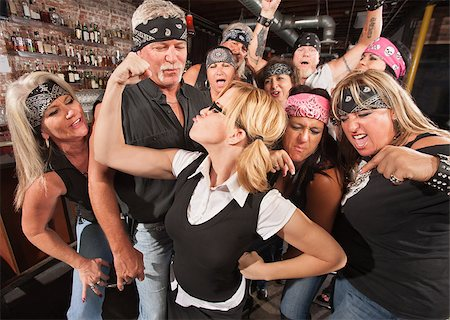 Biker gang cheering on skinny female nerd flexing muscles Stock Photo - Budget Royalty-Free & Subscription, Code: 400-06557773