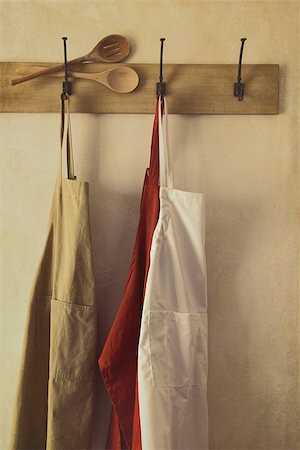 Kitchen aprons hanging on hooks with vintage feel Stock Photo - Budget Royalty-Free & Subscription, Code: 400-06558231