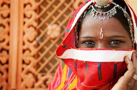 Traditional Indian woman in sari costume covered her face with veil, India Stock Photo - Budget Royalty-Free & Subscription, Code: 400-06558383