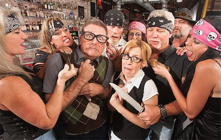 Biker gang mugging scared nerd couple in bar Stock Photo - Budget Royalty-Free & Subscription, Code: 400-06558605