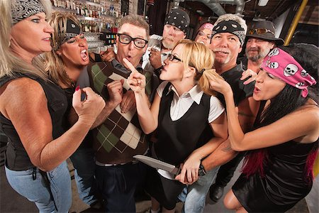 Female nerd with husband confronting biker gang thugs in bar Stock Photo - Budget Royalty-Free & Subscription, Code: 400-06558608