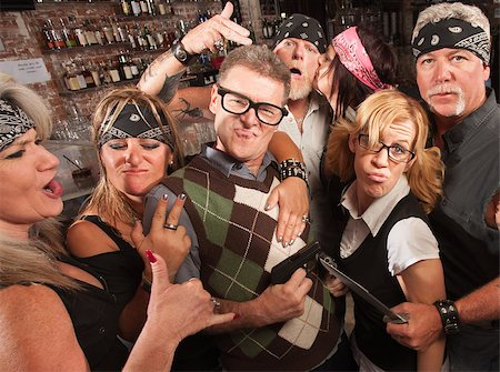 Nerd husband and wife being cool with biker gang in bar Stock Photo - Budget Royalty-Free & Subscription, Code: 400-06558609