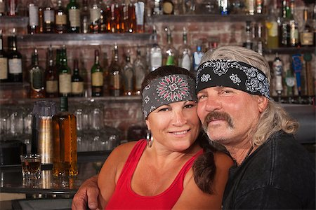 Cute motorcycle gang husband and wife together in bar Stock Photo - Budget Royalty-Free & Subscription, Code: 400-06558624