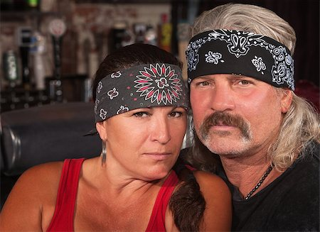 Serious middle aged couple in bandannas at a bar Stock Photo - Budget Royalty-Free & Subscription, Code: 400-06558625