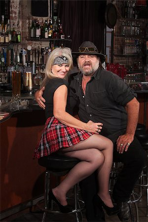 Happy middle aged motorcycle gang couple sitting at bar counter Stock Photo - Budget Royalty-Free & Subscription, Code: 400-06558622