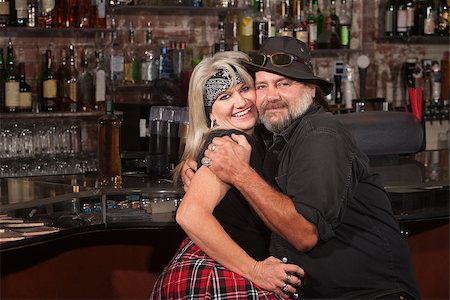 Happy middle aged couple embracing in a tavern Stock Photo - Budget Royalty-Free & Subscription, Code: 400-06558623