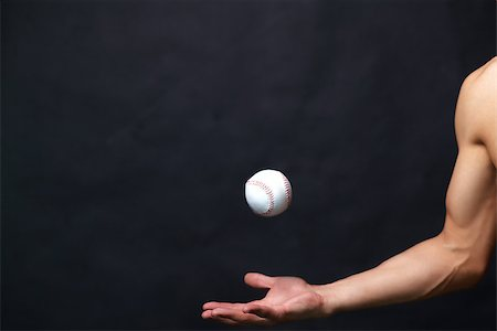 shirtless black boy - Image of male arm playing with baseball ball over black background Stock Photo - Budget Royalty-Free & Subscription, Code: 400-06564540