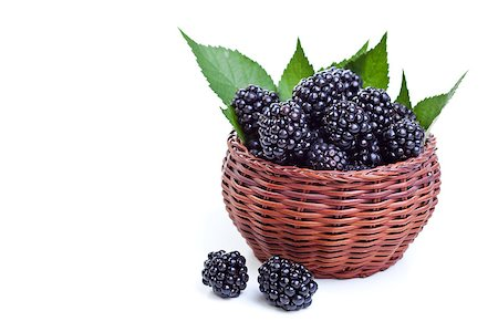 Fresh blackberries with leaves in a small basket - isolated with a bit of shadow Stock Photo - Budget Royalty-Free & Subscription, Code: 400-06568360