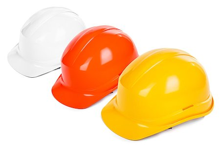 three hard hats on white background, focus set on the yellow one Stock Photo - Budget Royalty-Free & Subscription, Code: 400-06568756