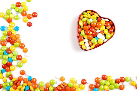Multicolor candies in heart shape candy box on white background Stock Photo - Budget Royalty-Free & Subscription, Code: 400-06560576