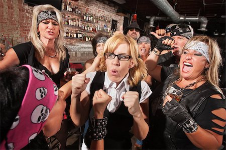 Motorcycle gang members force a fight with nerd in bar Stock Photo - Budget Royalty-Free & Subscription, Code: 400-06561339