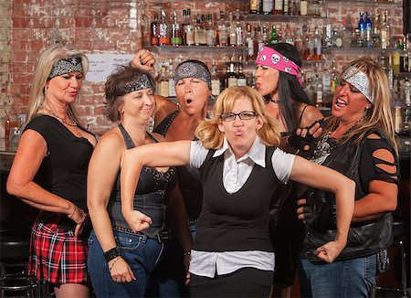 Female motorcycle gang laughing at nerd in bar Stock Photo - Budget Royalty-Free & Subscription, Code: 400-06561344