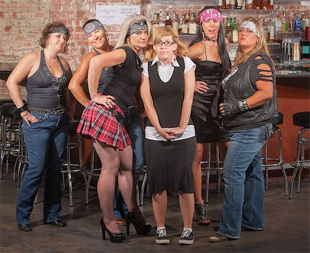 Nervous nerd lady in between gang of tough women in bar Stock Photo - Budget Royalty-Free & Subscription, Code: 400-06561346