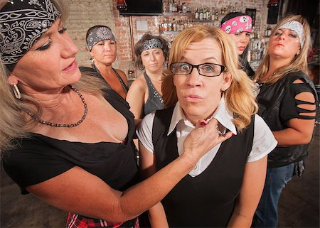 Tough biker gang woman with hand near female nerd's neck Stock Photo - Budget Royalty-Free & Subscription, Code: 400-06561348