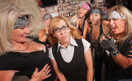 Frightened blond nerd laughed at by gang of women Stock Photo - Budget Royalty-Free & Subscription, Code: 400-06561349