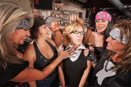 Female motorcycle gang touching a frightened nerd Stock Photo - Budget Royalty-Free & Subscription, Code: 400-06561342