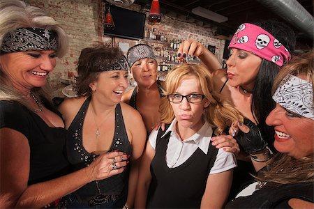 Cruel gang of mature women teasing a nerd in a bar Stock Photo - Budget Royalty-Free & Subscription, Code: 400-06561343