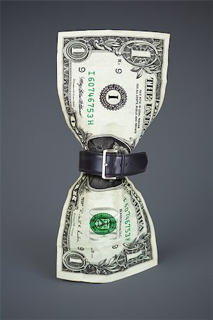 tighten belt on dollar concept Stock Photo - Budget Royalty-Free & Subscription, Code: 400-06562242