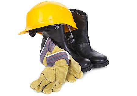 hard hat, boots and gloves on white background, minimal natural shadow among objects Stock Photo - Budget Royalty-Free & Subscription, Code: 400-06570785
