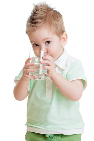 Little kid or child drinking water from glass isolated on white. It is a boy. Studio shot. Stock Photo - Budget Royalty-Free & Subscription, Code: 400-06638535