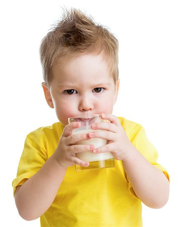 Funny angry kid drinking dairy product from glass isolated on white Stock Photo - Budget Royalty-Free & Subscription, Code: 400-06638540