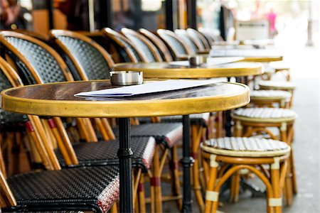 Street view of a coffee terrace with tables and chairs,paris France Stock Photo - Budget Royalty-Free & Subscription, Code: 400-06631256