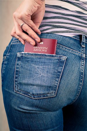 Shot of young womans behind in worn out jeans and passport in a pocket Stock Photo - Budget Royalty-Free & Subscription, Code: 400-06633713