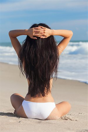 simsearch:400-04002563,k - A sexy young brunette woman or girl wearing a white bikini sitting on a deserted tropical beach with a blue sky Stock Photo - Budget Royalty-Free & Subscription, Code: 400-06633821