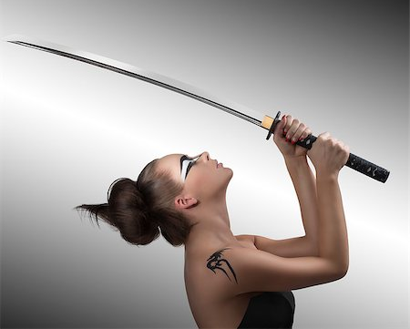 pretty brunette with japan make-up japan sword, she is turned in profile at left and takes the sword with both hands Stock Photo - Budget Royalty-Free & Subscription, Code: 400-06645295