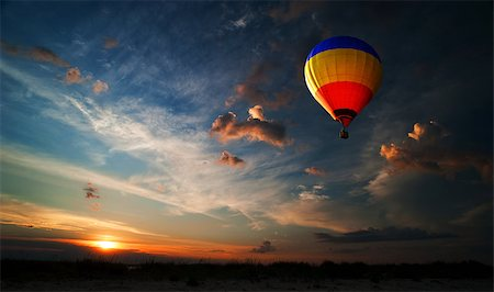 Colorful hot air balloon is flying at sunrise Stock Photo - Budget Royalty-Free & Subscription, Code: 400-06642893