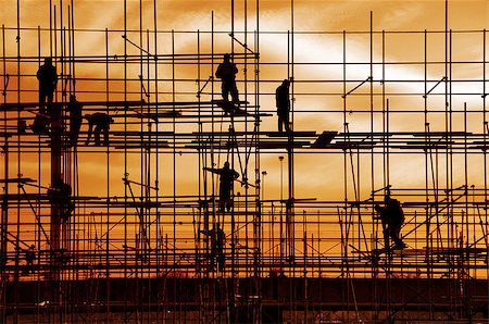 Construction site, silhouettes of workers against the light Stock Photo - Budget Royalty-Free & Subscription, Code: 400-06643754
