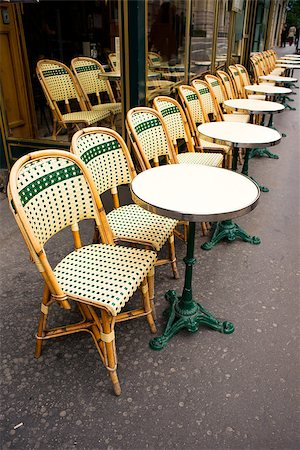 Street view of a coffee terrace with tables and chairs,paris France Stock Photo - Budget Royalty-Free & Subscription, Code: 400-06687702