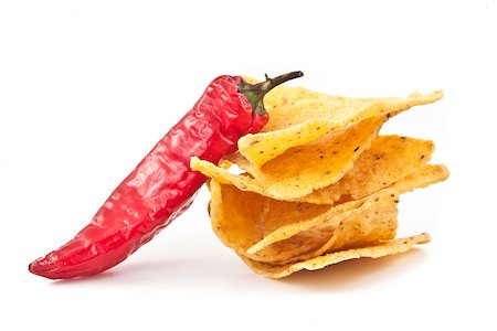 pimento - Pepper beside a small stack of crisps against white background Stock Photo - Budget Royalty-Free & Subscription, Code: 400-06689583