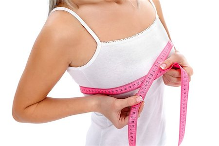 Young woman measures her breast with a measuring tape Stock Photo - Budget Royalty-Free & Subscription, Code: 400-06694202
