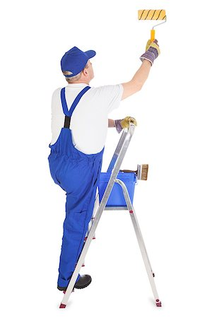 house painter on the ladder is painting invisible wall Stock Photo - Budget Royalty-Free & Subscription, Code: 400-06698480