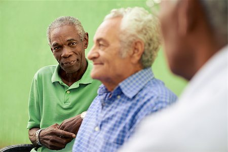 diego_cervo (artist) - retired elderly people and free time, group of happy senior african american and caucasian male friends talking and sitting on bench in park Stock Photo - Budget Royalty-Free & Subscription, Code: 400-06698763