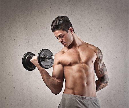 Muscular man shirtless raising a dumbbell Stock Photo - Budget Royalty-Free & Subscription, Code: 400-06735878