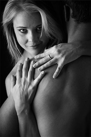Young and fit caucasian adult couple in an embrace. Semi-nude and topless against a dark background. Black and White Stock Photo - Budget Royalty-Free & Subscription, Code: 400-06736224