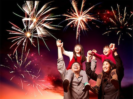 happy asian family looking fireworks Stock Photo - Budget Royalty-Free & Subscription, Code: 400-06736434