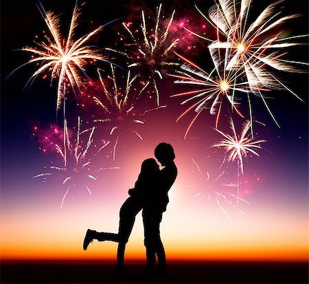 silhouette of firework - happy young couple with fireworks background Stock Photo - Budget Royalty-Free & Subscription, Code: 400-06736431