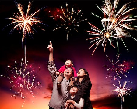 happy family looking fireworks in the evening sky Stock Photo - Budget Royalty-Free & Subscription, Code: 400-06736432