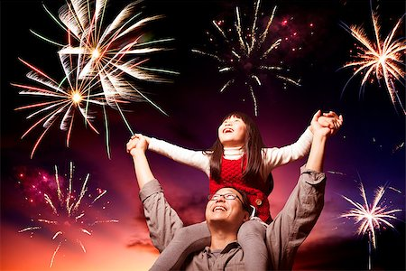 father and daughter looking fireworks in the evening sky Stock Photo - Budget Royalty-Free & Subscription, Code: 400-06736433