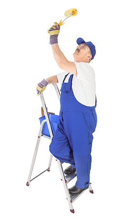 house painter on the ladder is painting invisible ceiling Stock Photo - Budget Royalty-Free & Subscription, Code: 400-06737545