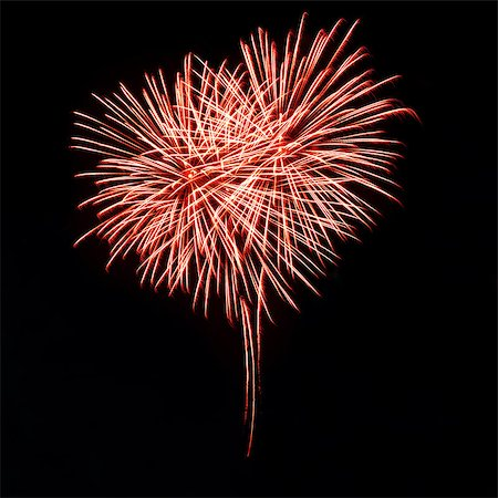 Bright red fireworks in the night sky in the form of heart Stock Photo - Budget Royalty-Free & Subscription, Code: 400-06745166
