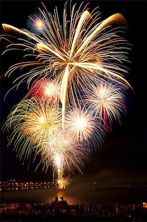 Brightly colorful fireworks and salute of various colors in the night sky Stock Photo - Budget Royalty-Free & Subscription, Code: 400-06745171
