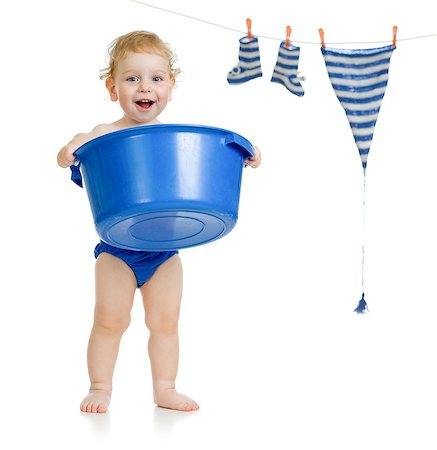 Happy kid washing his accessories Stock Photo - Budget Royalty-Free & Subscription, Code: 400-06747115