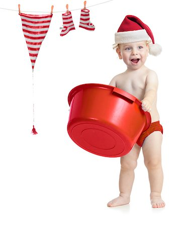 Happy kid in Santa's hat washing his accessories Stock Photo - Budget Royalty-Free & Subscription, Code: 400-06747117