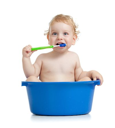 Happy baby kid brushing teeth sitting in basin Stock Photo - Budget Royalty-Free & Subscription, Code: 400-06747113