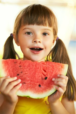 Pretty girl holding a piece of watermelon Stock Photo - Budget Royalty-Free & Subscription, Code: 400-06747345